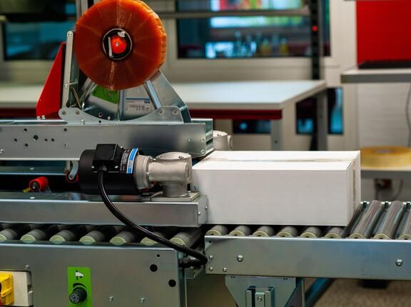Automatisierung der Fördertechnik durch eine elektronische Packstation